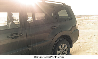 SUV parked on the beach