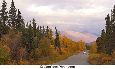 SUV Travels Remote Alaska Road Fall Winter Approaching - A...