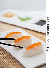 Suziki Nigiri Sushi - Close up of Suzuki Nigiri Sushi with ...