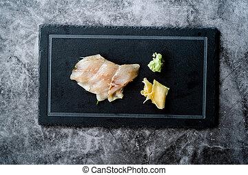 Suzuki Fish Sashimi with Pickled Ginger and Wasabi on Black ...