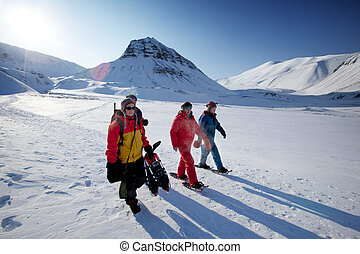 Svalbard Tourism - A group of tourists and a guide near...