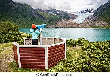 Svartisen Glacier in Norway. Tourist girl looking Glacier.