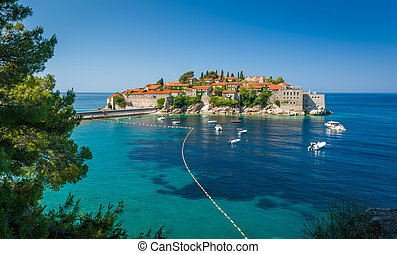 Sveti Stefan small island view from pedestrian walking route in the green park, nearby. Budva, Montenegro.