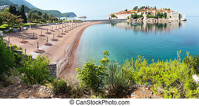 The view of Sveti Stefan sea islet with pink sandy Milocer Beach (Montenegro, 6 kilometres southeast of Budva)