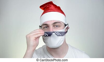 Swag Santa Claus in protective medical mask in funny pixelated sunglasses on white background. Covid Party time, Happy New Year, Quarantine Merry Christmas, celebration concept