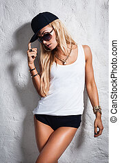 Swag style babe - Swag style dressed young woman posing near...