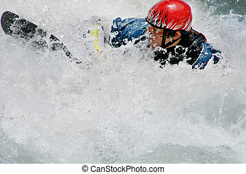 A man and kayak are engulfed in whitewater