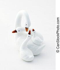 Swan family figures over white