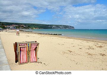 Swanage Beach, Dorset, at the start of the holiday season. Part of the UNESCO Jurassic coast