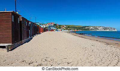 Swanage Beach Dorset England UK - Beach huts and blue sky at...