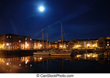 Swansea Marina and surrounding luxury apartment buildings, taken by moonlight