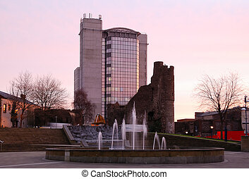 Old and new - Swansea castle, in front of a modern high-rise building. Taken at sunrise.