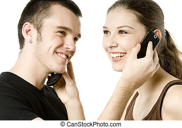 Swapping Phones - A young man and a young woman swapping...