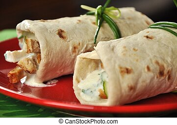 Two shawarmas on red plate ready to eat.