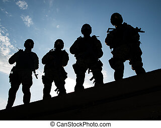 S.W.A.T. - Silhouettes of S.W.A.T. officers holding their...
