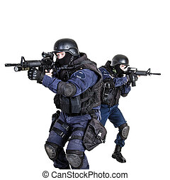SWAT team in action - Special weapons and tactics (SWAT) ...