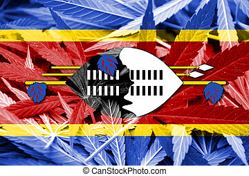 Swaziland Flag on cannabis background. Drug policy....