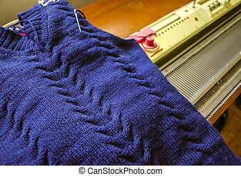Sweaters made on  hand knitting machine