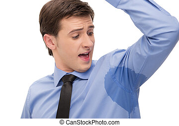 Sweaty armpit - Young man is sweating a lot. Looking with...