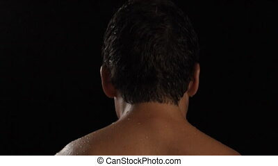 Sweaty athlete - Intense sweaty male athlete turns to look...
