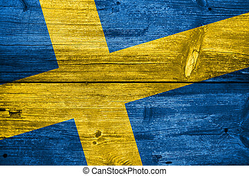 Sweden Flag painted on old wood plank background