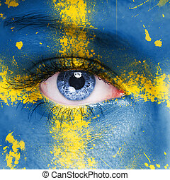 Sweden flag painted on woman face