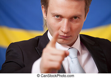 politician speaker in front of a sweden flag