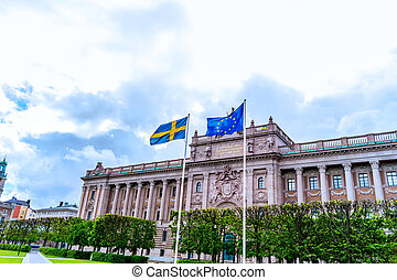 Swedish and EU flags in front of swedish parliament