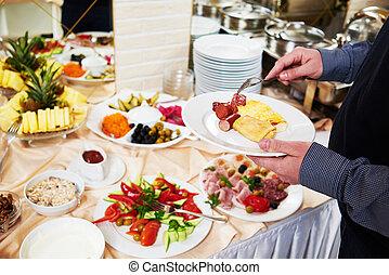swedish buffet style breakfast eating - Hotel restaurant...