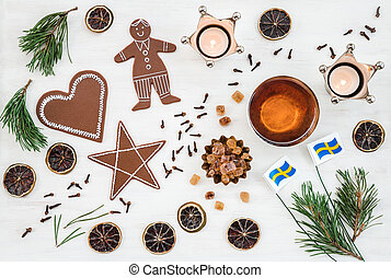 Swedish Christmas decor with flags, candles and ginger biscuits