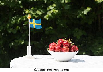 Swedish flag and strawberries
