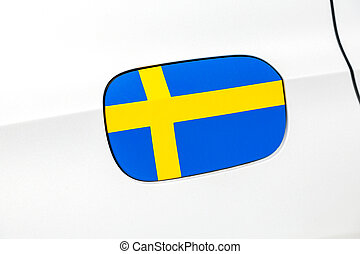 Swedish flag on a car gas tank hatch close up