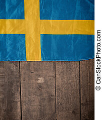 Swedish flag on wood