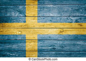 swedish flag on wood texture background