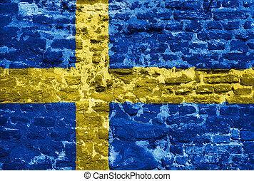 Swedish flag over old wall