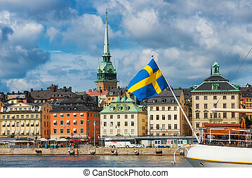 Swedish flag with the old town as backdrop, Stockholm
