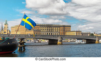 Swedish flag with the Royal Castle in the background,...