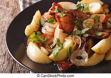 Swedish Food: Fried bacon with onions and apples macro. horizontal