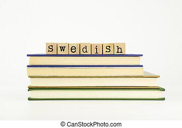 swedish language word on wood stamps and books