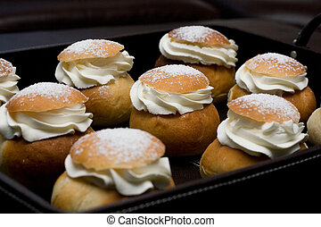 A tray full of the swedish pastry called Semla