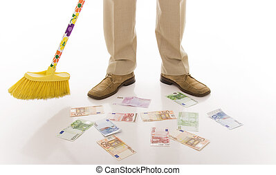 Sweep - business man sweeping euro banknotes on the floor