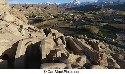 Sweeping aerial zoom of Bamyan Valley from Shar-e Gholghola...