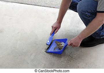 Sweeping Floor Dirt into a Dustpan