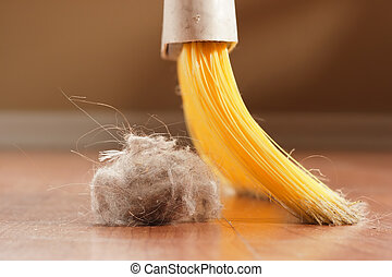 Sweeping - A broom about to sweep up a giant ball of dust