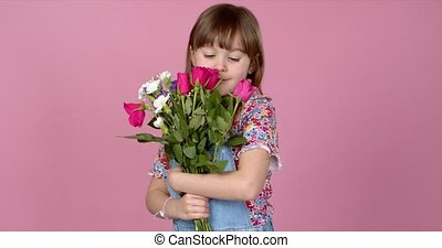Sweet adorable young little girl holding bunch of fresh ...