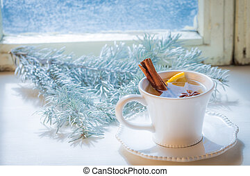 Sweet and aromatic tea with cinnamon for Christmas