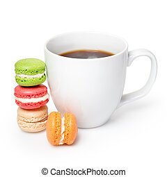 Sweet and colorful macaroons with cup of coffee on white background. Traditional french dessert macarons