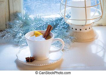 Sweet and hot tea with cinnamon for Christmas