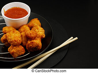Sweet and sour battered chicken balls