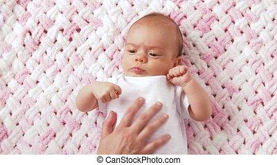 sweet baby girl lying on knitted plush blanket - babyhood,...